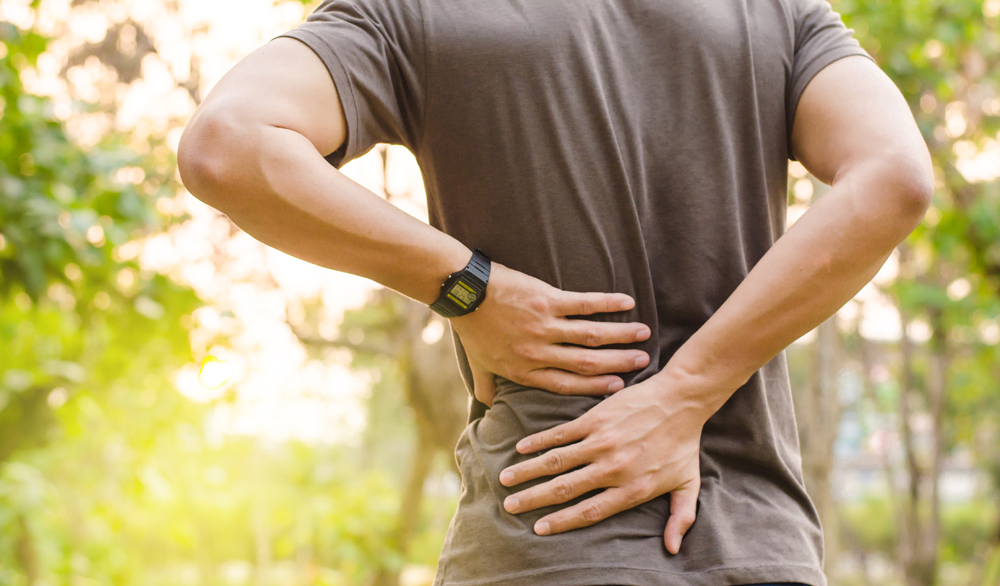 man has back pain in Thousand Oaks