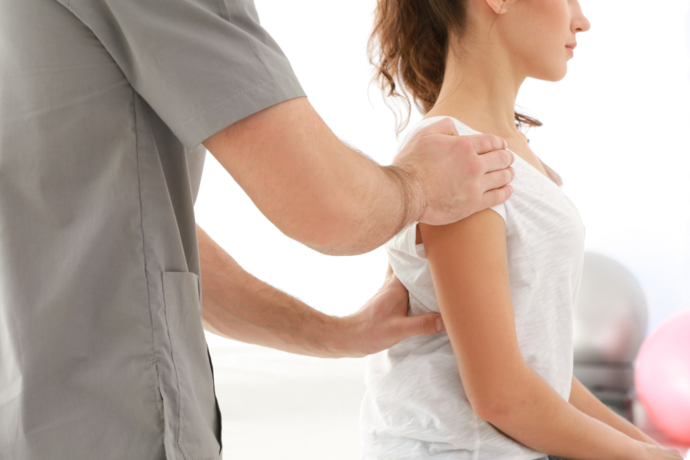 Chiropractor treating patient for herniated disc